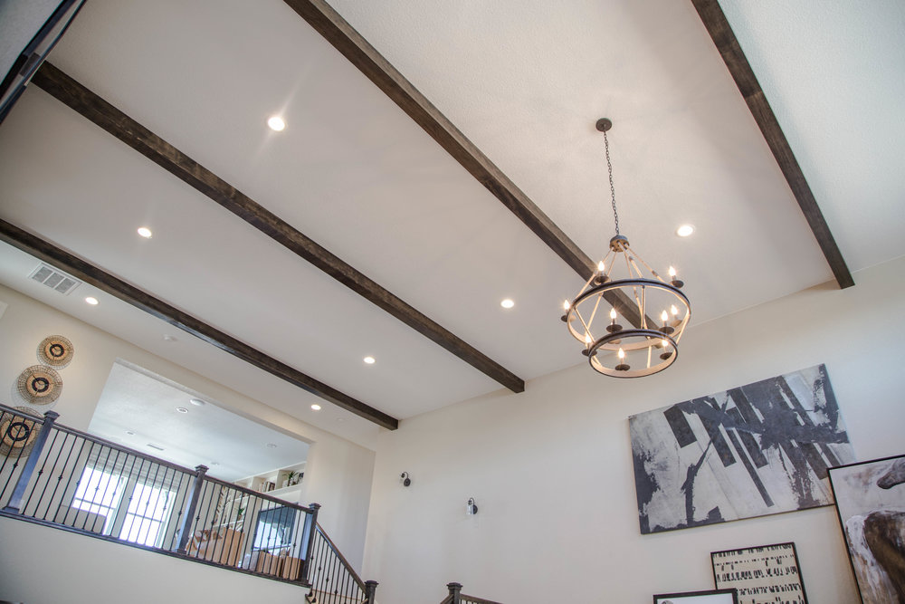 Recessed LED Can Lights accentuate the affect of this custom chandelier