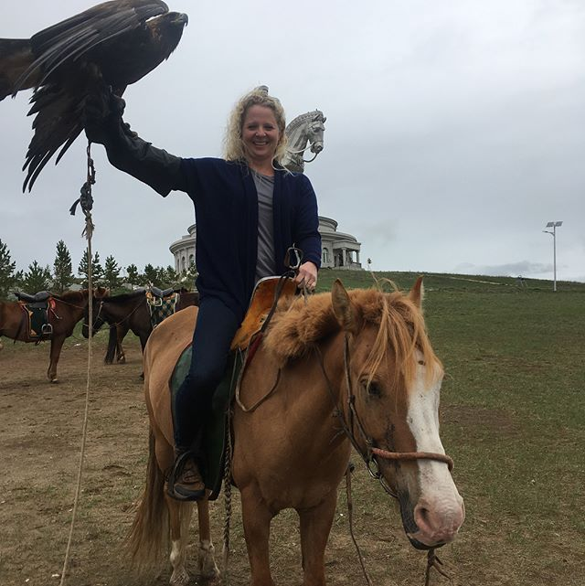 Sorry for the delay in posts. Lots of life change happened in the last few months.  This is a pic taken at the Chinggis Khan Memorial. It was our first encounter with a Mongolian horse and golden eagle.  Little did we know that just a few days later, we would have a different kind of experience with a golden eagle. As we came over a hill an eagle rose up from the ground and spooked our horses in different directions, sending Clare flying in the opposite direction of her horse. We were very fortunate in quickly catching her horse and we continued on.