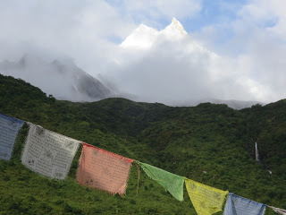 Manaslu peaks through the clouds