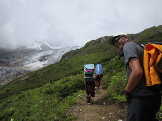Porters carrying our loads to base camp