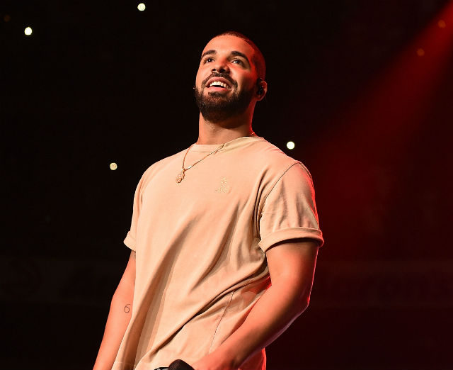 """Besides being 2016's most streamed artist, Drake accomplished many things this year. He also announced an upcoming music project, More Life, which will release in 2017. Drake doesn't consider the project an album, but he considers it more of a playlist. One of the singles off the playlist, """"Fake Love,"""" is already a hit on the radio. The rapper made more Billboard history today as """"he ties Lil Wayne for the most Hot 100 appearances among soloists."""" Drake is indeed unstoppable."""