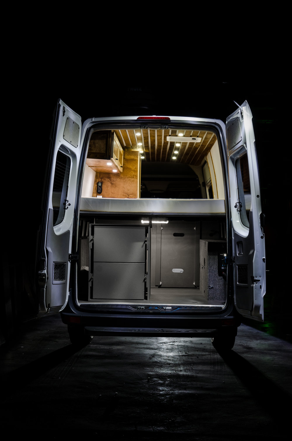 "This vehicle also features a hand made ""slatted"" ceiling complete with LED lighting throughout."