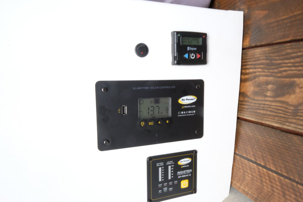 "A Go-Power solar set up, inverter, and controller take care of the electrical needs.  Meanwhile, the fuel efficient Espar diesel fired heater runs warmly and quietly under the control of an easy to use ""set it and forget it"" thermostat."