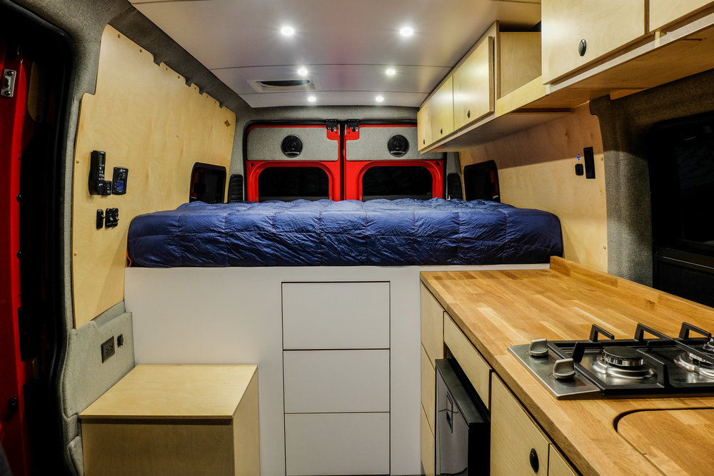 """A 6"""" queen+ memory foam mattress sits on top of an elevated 36"""" bed platform. The elevated bed allows room for Rob's two mountain bikes to be safely stowed using the RockyMounts bike storage system."""