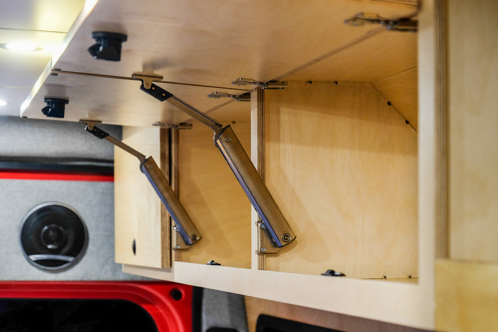 The custom CNC cut maple cabinetry was designed to withstand all of the moving and shaking that comes with life on the road. All cabinet doors and drawers have been fitted with touch-to-open hardware so they can stay securely closed on even the bumpiest of mountain roads.