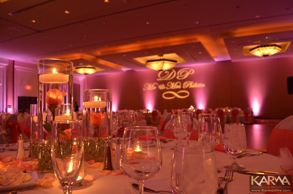 Purple and amber uplighting with monogram
