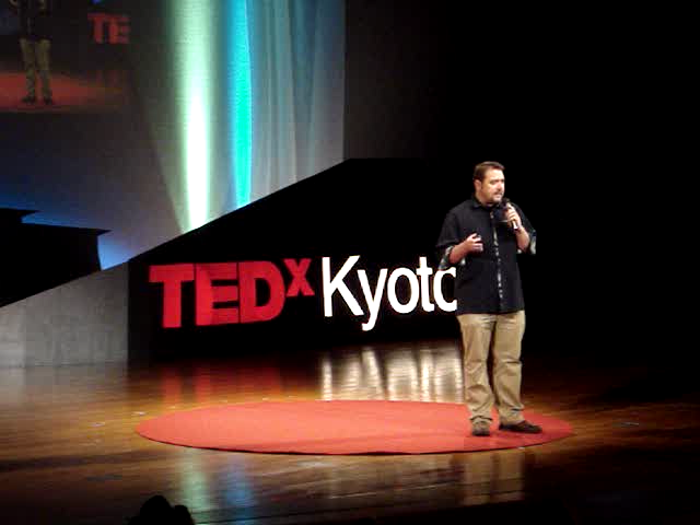 Eric presenting at a TED talk in Japan