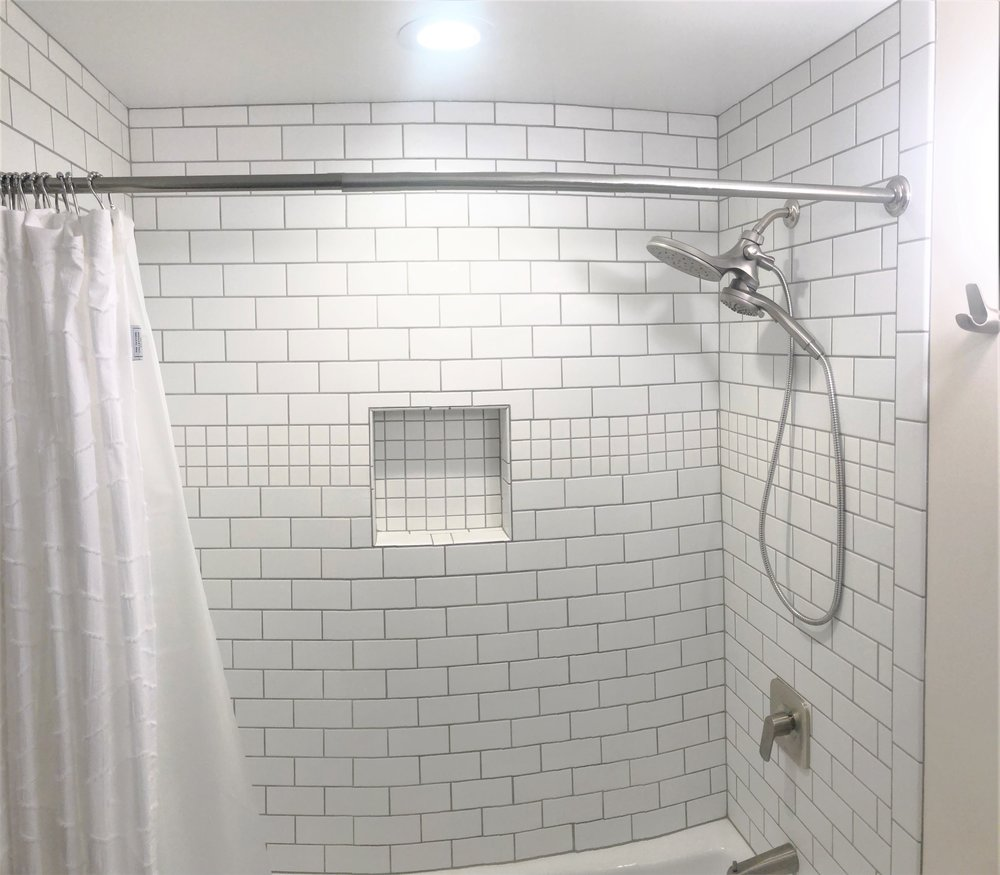 Subway tiled shower.