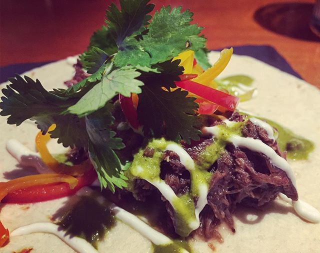 Mole' Boar Tacos  With fresh cilantro, sour cream and pickled peppers. 🍃 #wildboarmeat #tacolovers #tacotime #cilantro #cilantrolover #pickledpeppers #deliciousness #itsfridaynight #tequila #cocktailtime #tequilapairing #gastroart #snacktime #betyoucanteatjustone #cowichanvalley #cowichanfoodies #downtownduncan #duncancitysquare #theoldfirehousewineandcocktailbar #theoldfirehouse #cheflove #tacogoals #eatfresh #eatlical #eatbetter #locavore