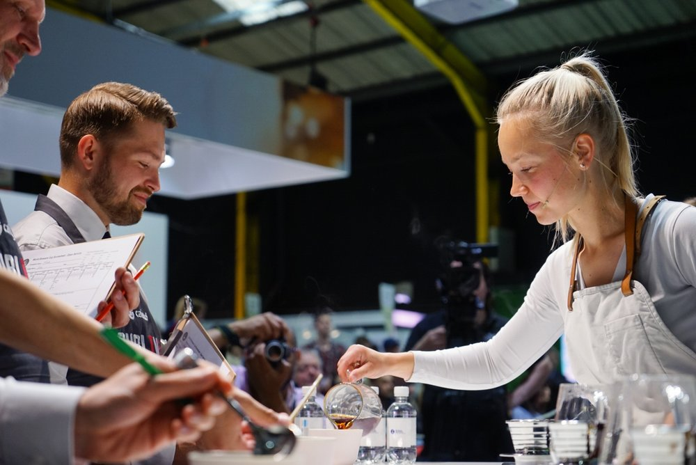 Mikaela serving her signature coffee in our cups at Barista World Championship 2016.