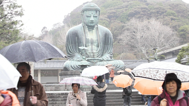 We had one day to make a film about  Kamakura . We'd dropped off our kids in a Tokyo daycare center and took the train south to the Izu peninsula and made our way straight to the Daibutsu. While there it started raining and I was getting pretty miserable but later when we looked at the footage we loved the textures of Kamakura on a rainy day and the parasols and umbrellas and misty overcast weather gave us some untypical images and I ended up liking the video a lot.