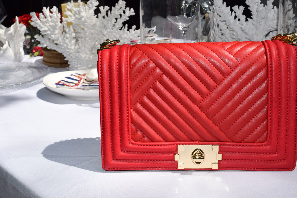 This red clutch is perfect for not just the 4th but for any occasion you want to sass up a low key outfit.