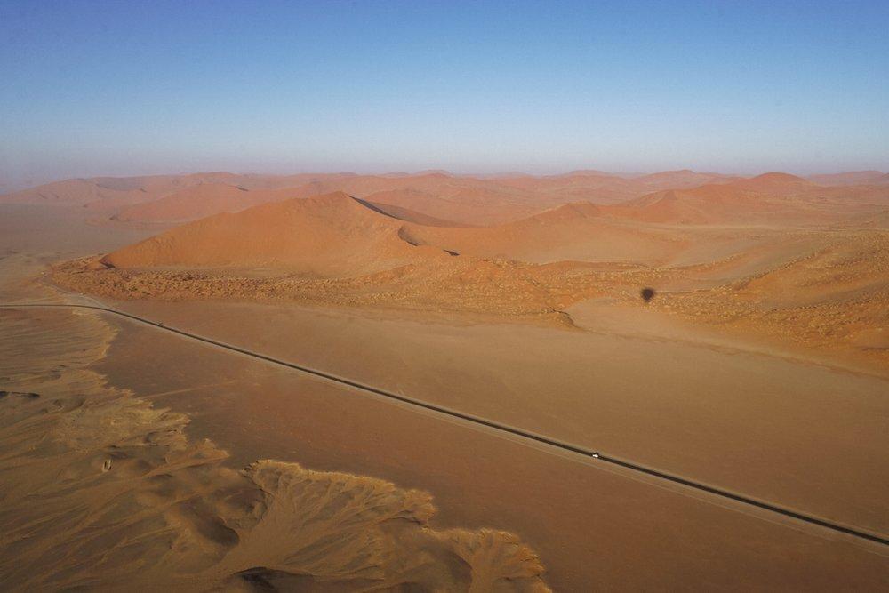 curio.trips.namibia.sossusvlei.hot.air.balloon.dunes.shadow.landscape.jpg