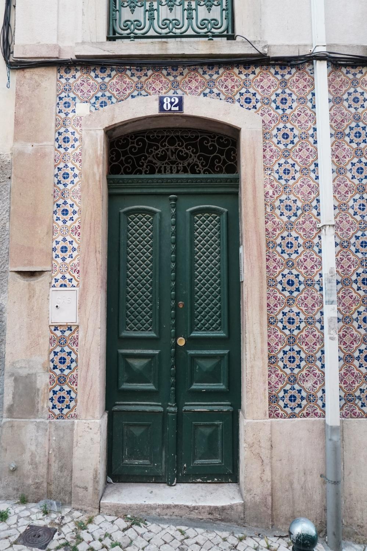 curio.trips.portugal.lisbon.door.pink.tiles.jpg