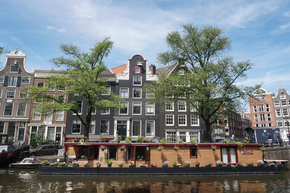 curio.trips.amsterdam.canal.house.boat.landscape.jpg