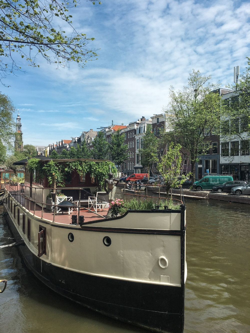 curio.trips.amsterdam.canal.house.boat.jpg