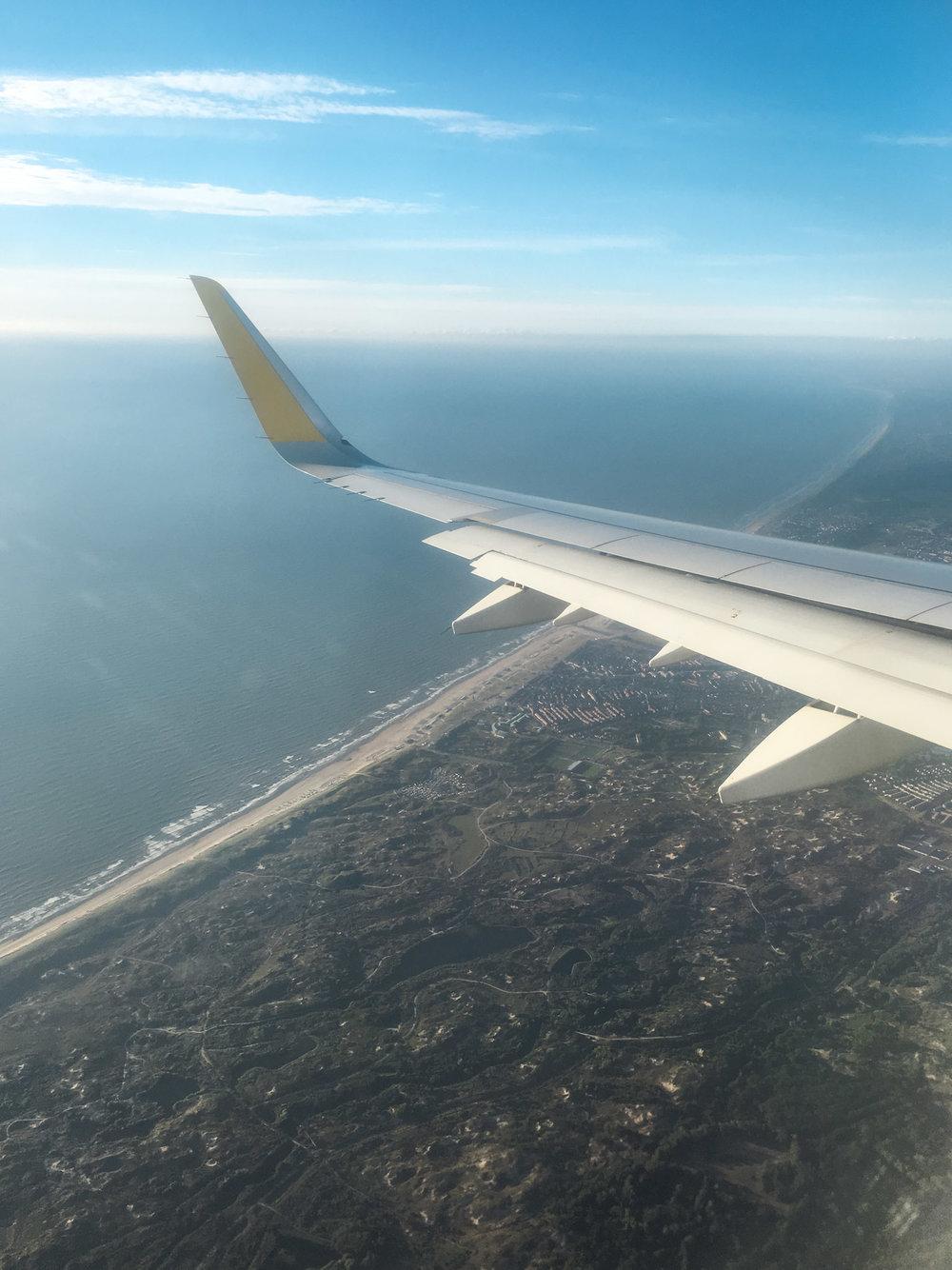 curio.trips.amsterdam.plane.iphone.jpg