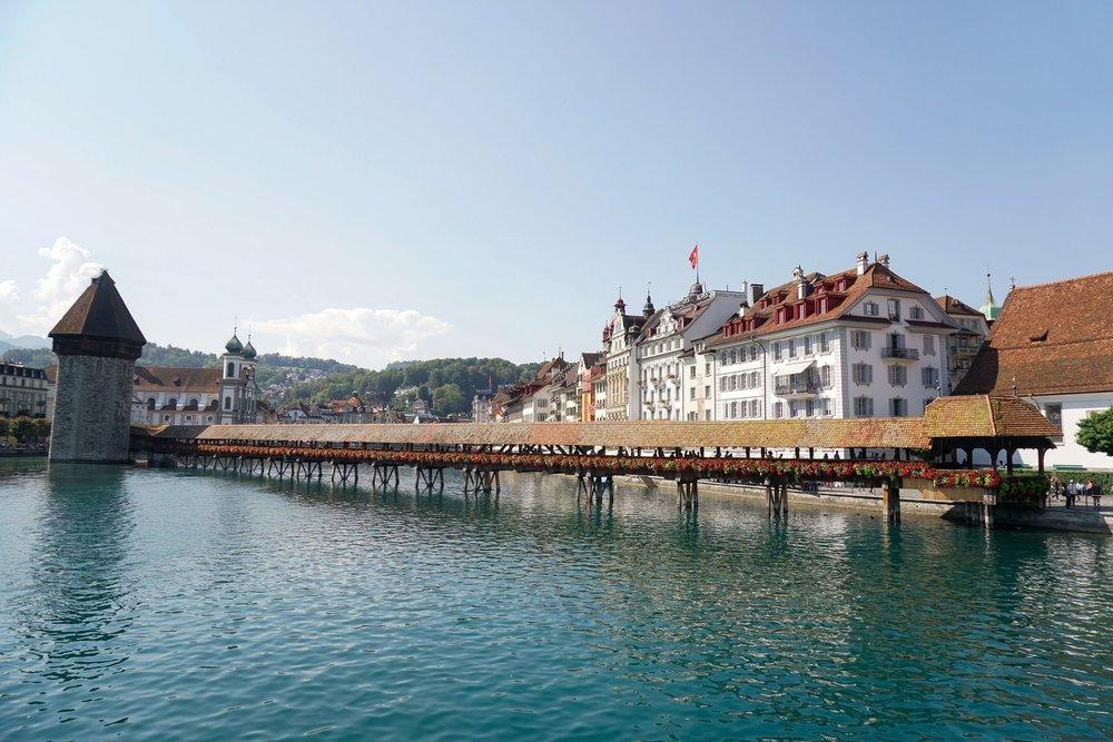 curio.trips.switzerland.lucerne.lake.bridge.architecture.landscape.jpg