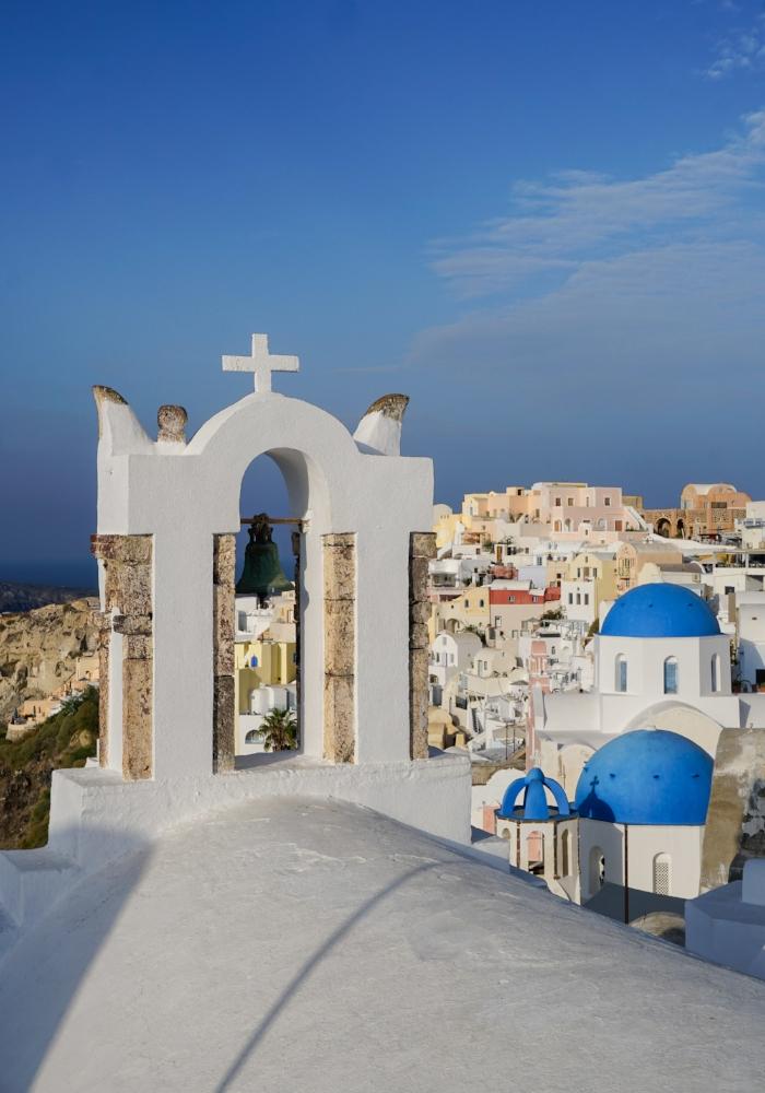 curio.trips.greece.santorini.architecture.white.black.churches.view.portrait.jpg