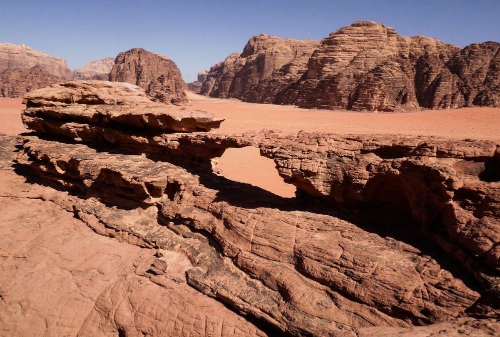 curio.trips.jordan.wadi.rum.arch.landscape.jpg