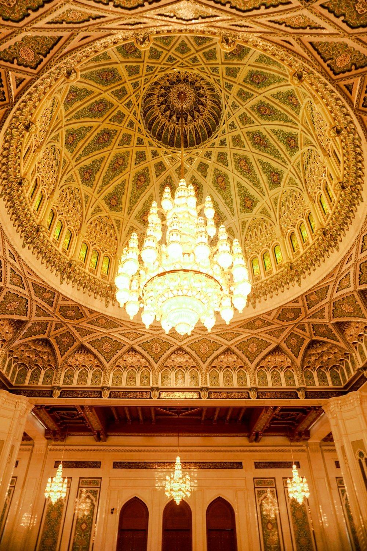 curio.trips.oman.mosque.green.arch.portrait.jpg