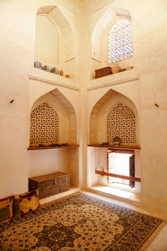 curio.trips.oman.nizwa.castle.interior.windows.rug.portrait.jpg