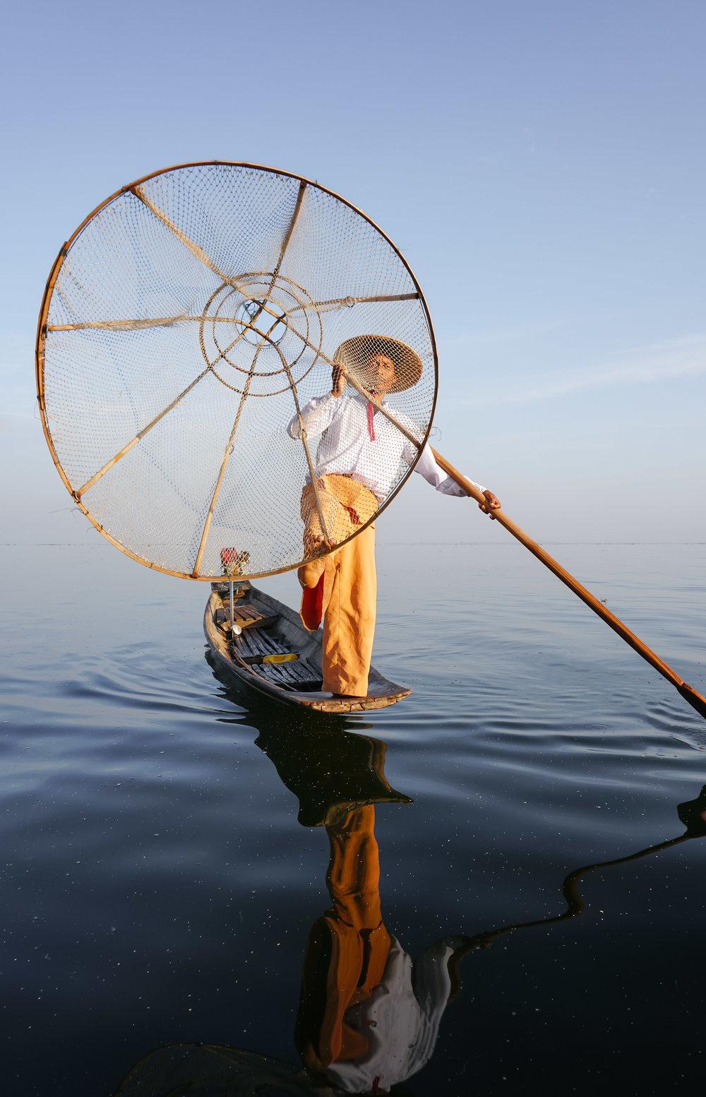 curio.trips.myanmar.inle.lake.fisherman.net.portrait-2.jpg