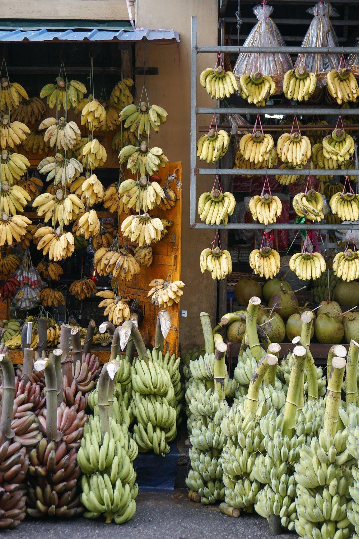 curio.trips.myanmar.yangon.street.banana.shop.portrait.jpg