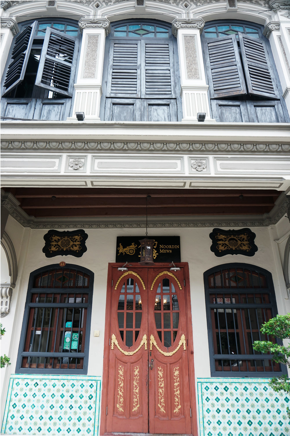 curio.trips.malaysia.penang.red.door.shutter.architecture.portrait.jpg