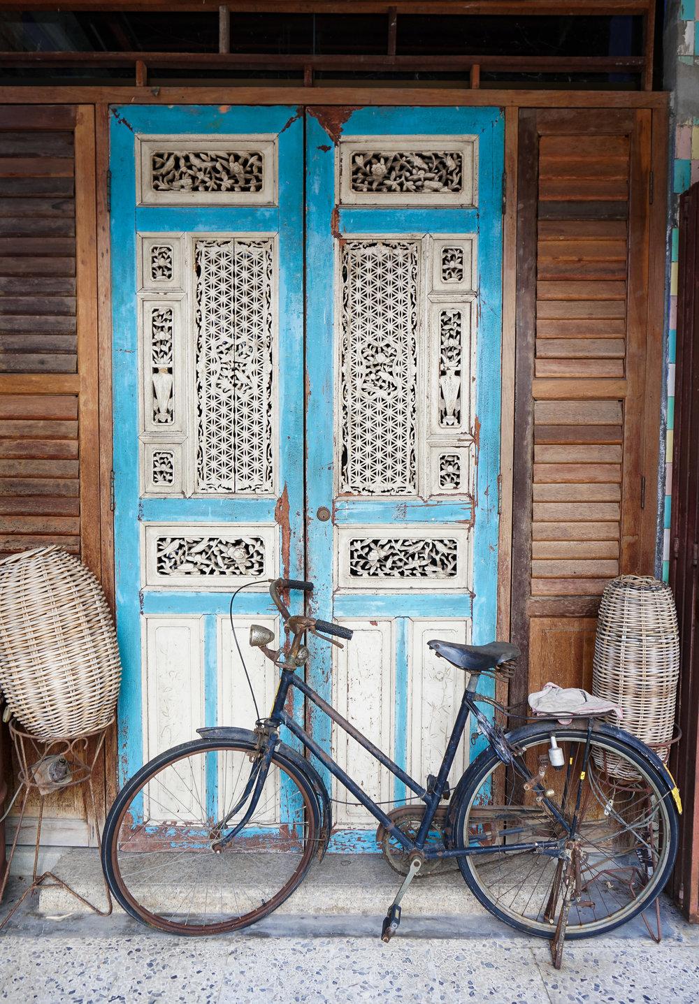 curio.trips.malaysia.penang.blue.door.bike.portrait.jpg