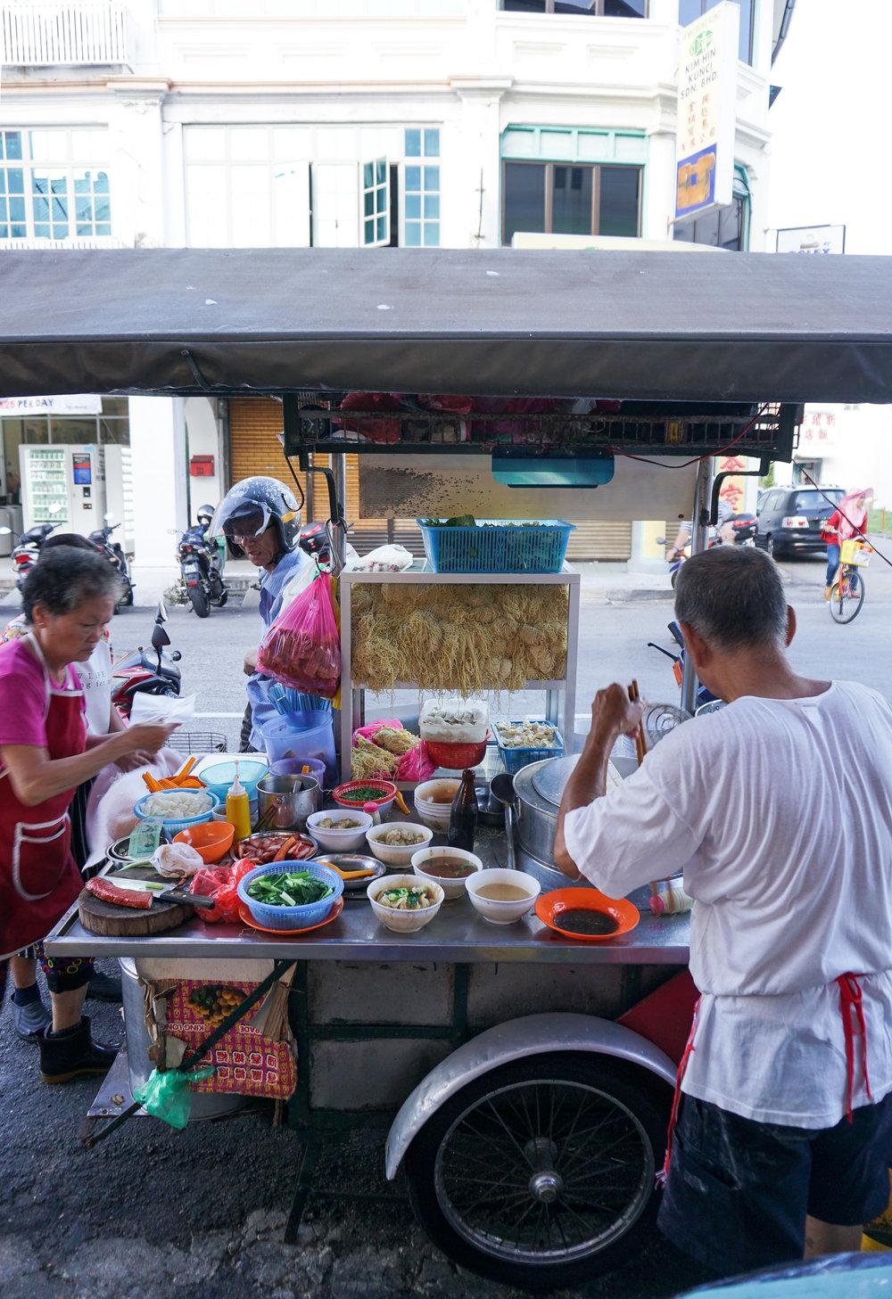 curio.trips.malaysia.penang.street.food.stall.husband.wife.portrait.jpg