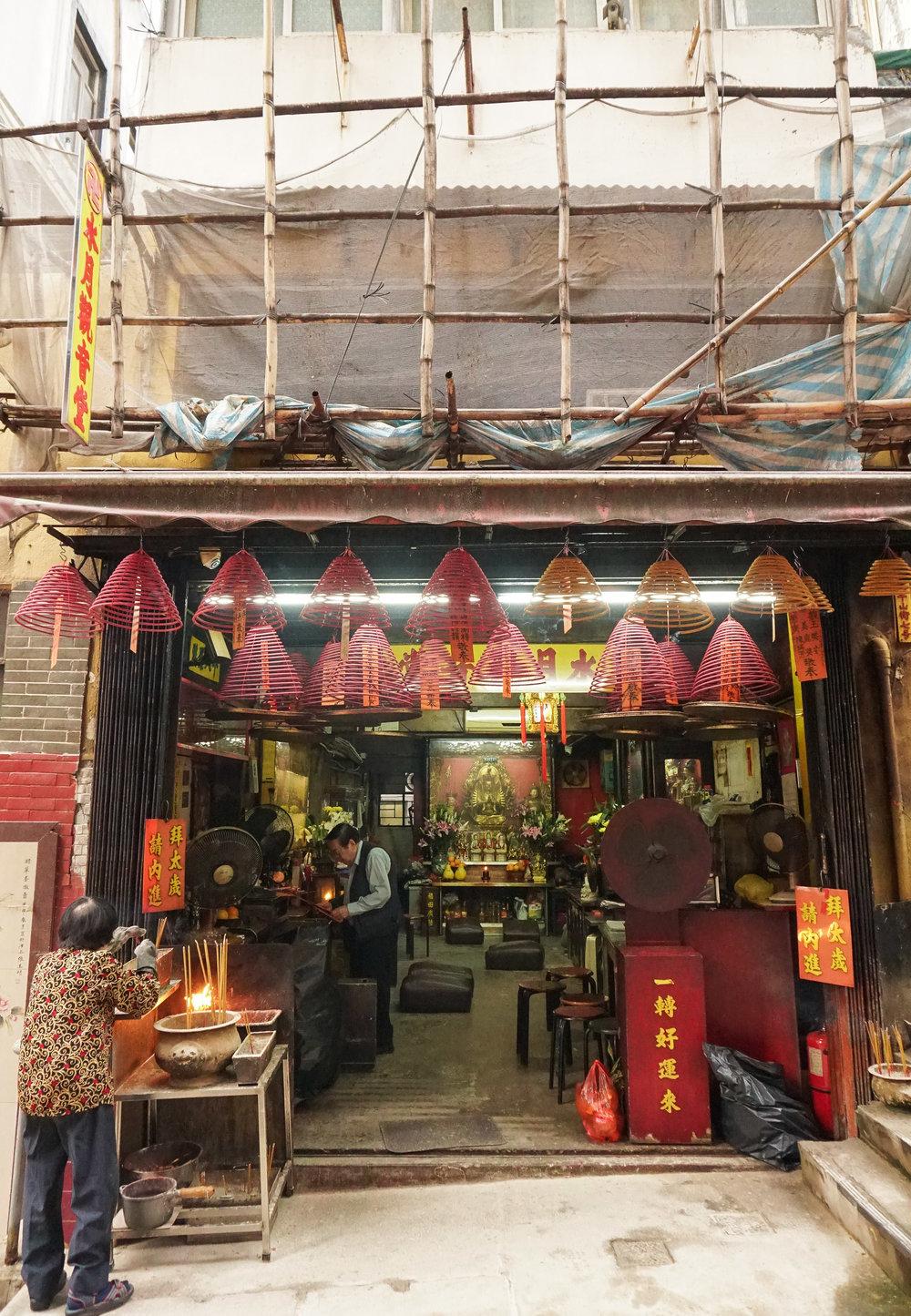 curio.trips.hong.kong.pink.orange.incense.shop.couple.portrait.jpg