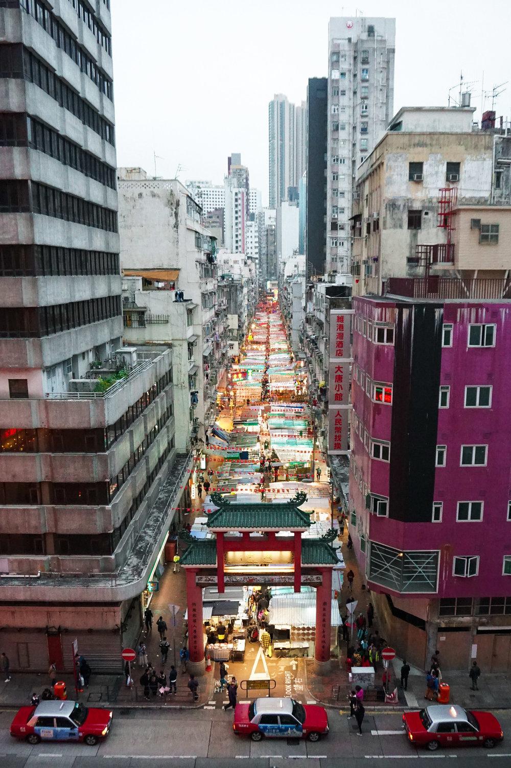 curio.trips.hong.kong.temple.street.night.market.three.taxis.portrait.jpg