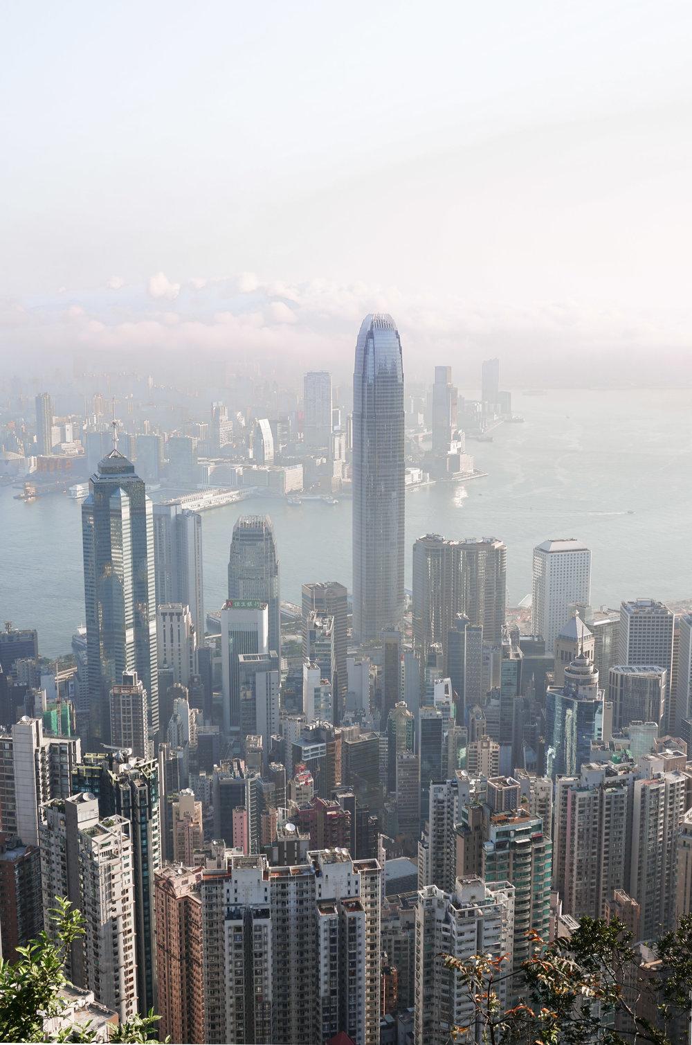 curio.trips.hong.kong.peak.cityscape.pink.sunrise.portrait.jpg