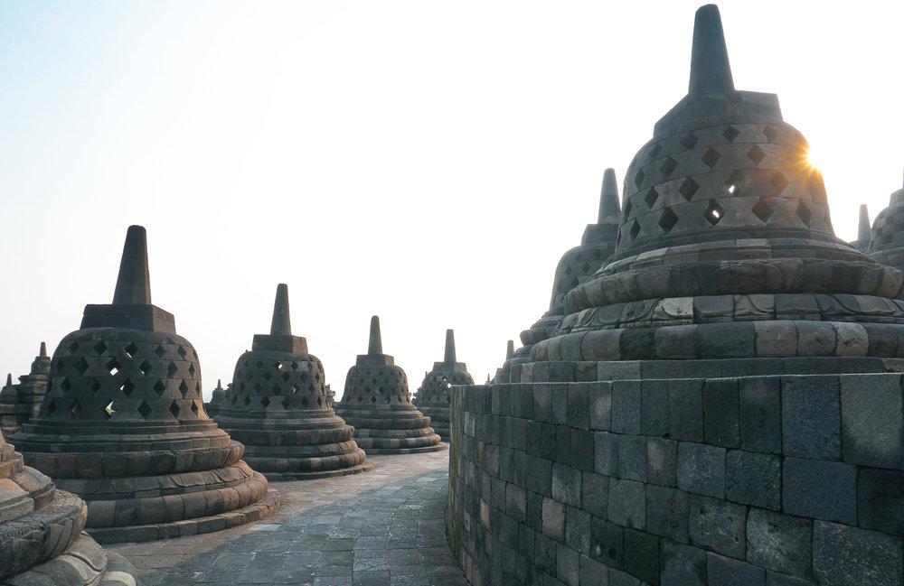 curio.trips.indonesia.java.temple.bells.sun.landscape-2.jpg