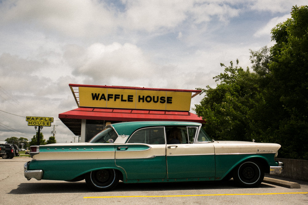 The 59 Merc in front of Waffle House, a dietary cornerstone of the trip.