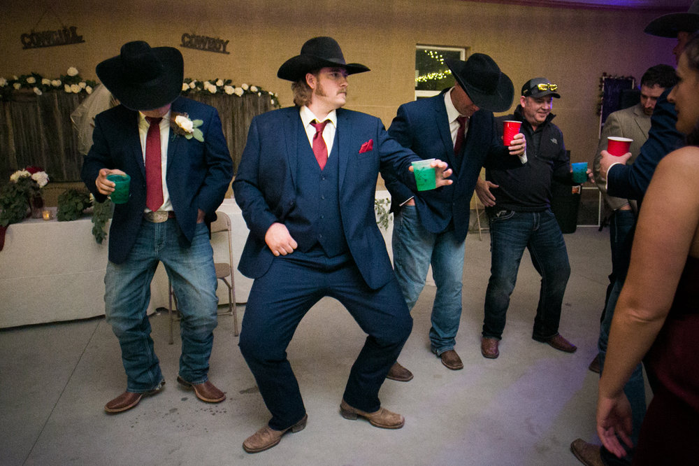Montana cowboy busts a move on the dance floor at a wedding.