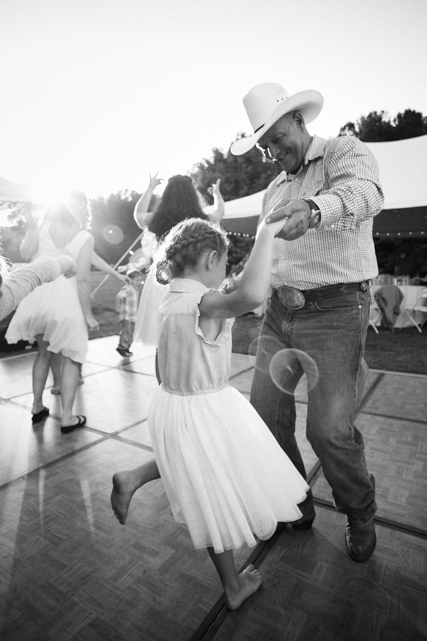 Dancing with grandpa at a wedding.