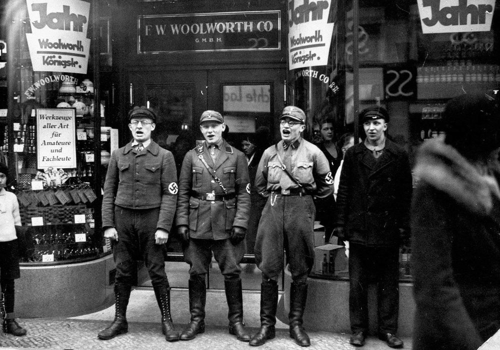 Nazis singing to encourage a boycott of the allegedly Jewish-founded Woolworths, 1933.jpg