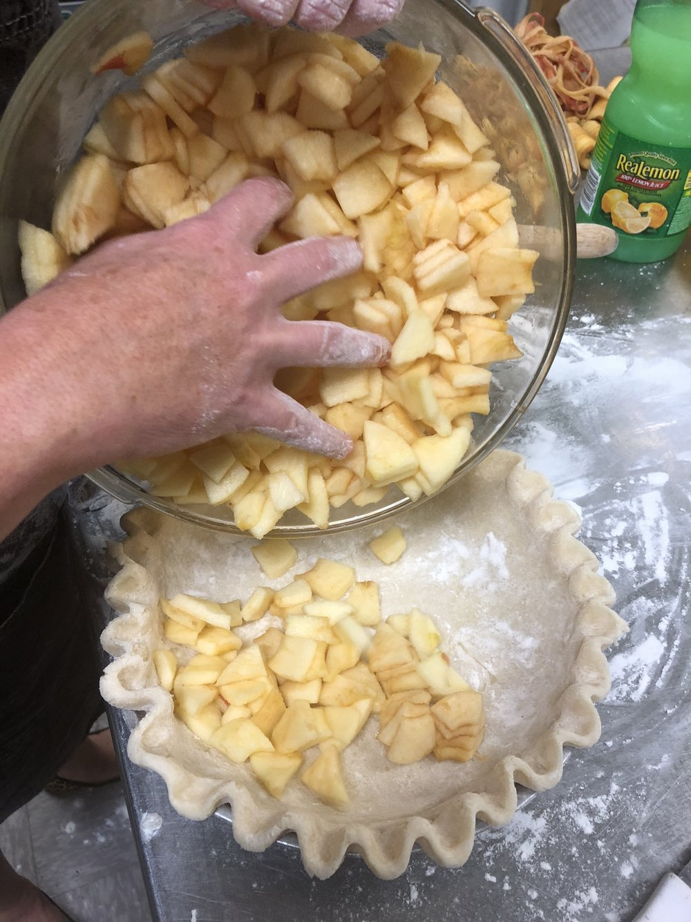 - Pour the apples into the pie crust.