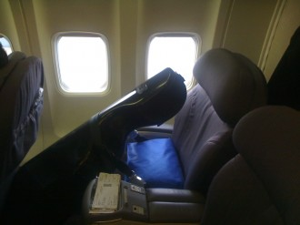 Midge enjoying the benefits of the frequent flier program. Extra bridge room in First Class!
