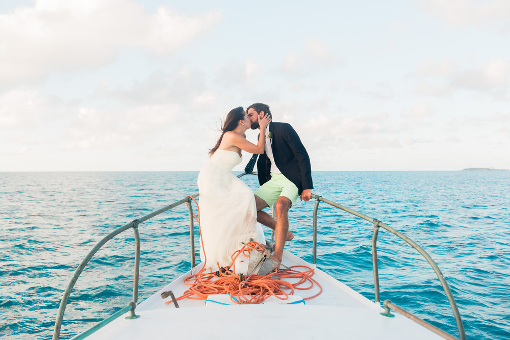 Jim (Captain of Early Bird Charters) & Melanie (Photographer of Fiander Foto) aboard Troubadour for Their Wedding. Photo by: Corbin Gurkin