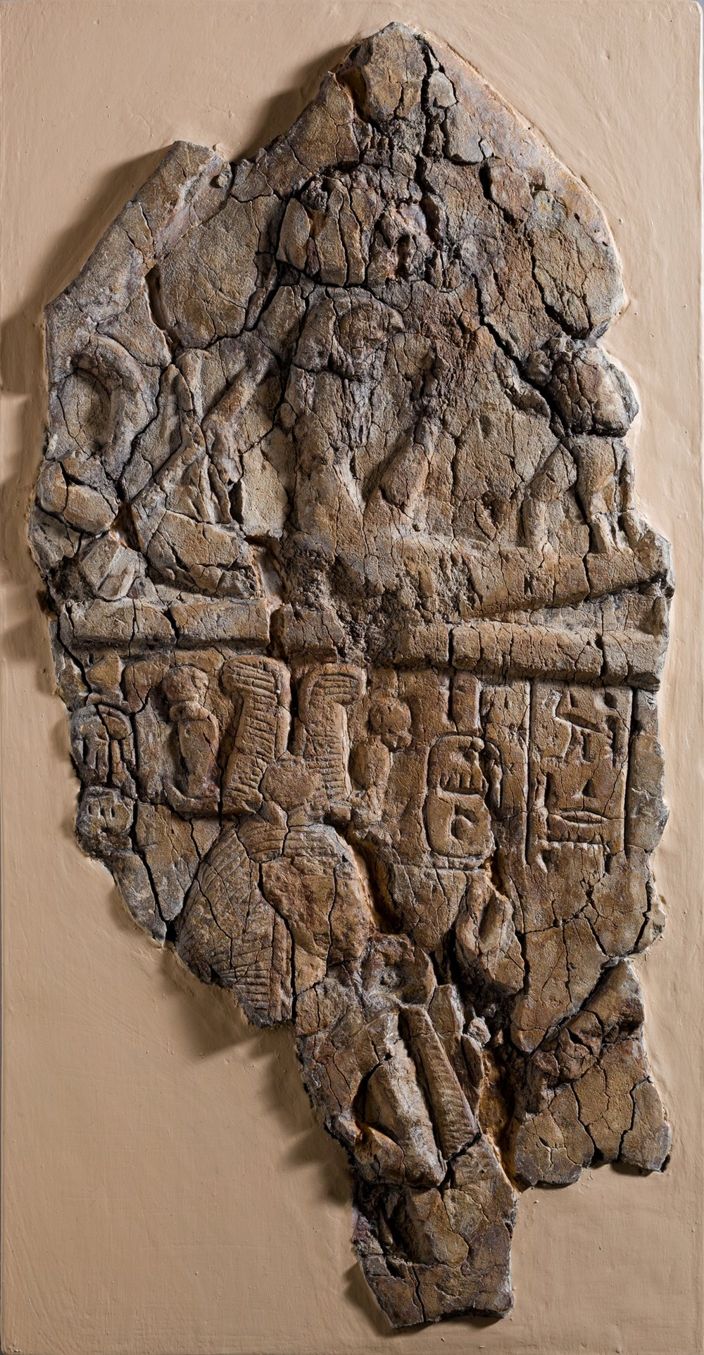 Fragment of Stela depicting a figure labeled 'excellent spirit of Re' facing Ramesses I and Ahmose-Nefertari beneath the barque of Re,ca. 1295–1070 B.C. Collection of the Metropolitan Museum of Art.