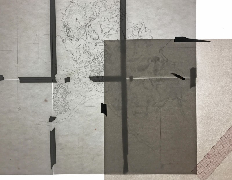 Tracing elements on a light box in order to repeat them across the layout
