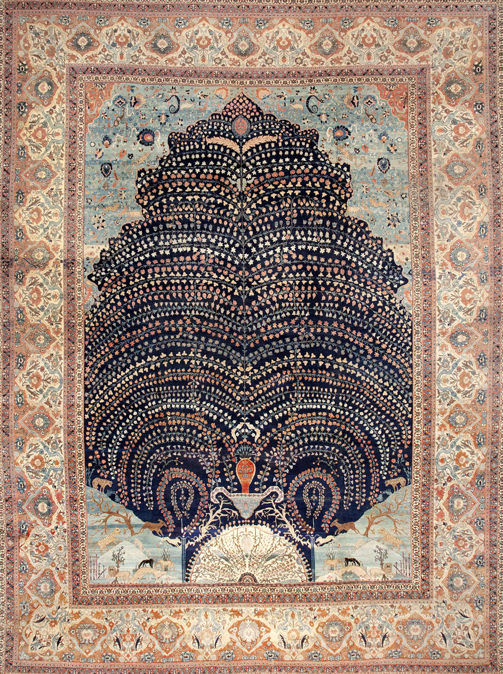 """The Tree of Life and the vase are recurring motifs in Islamic rugs (""""Vase"""" or """"Kerman"""" rugs are actually their own subset of Persian rugs)."""