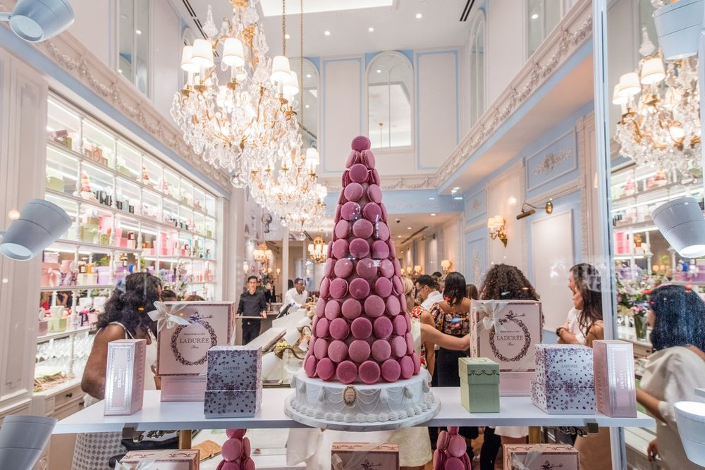 A view of DC's Ladurée through the window display during its opening. Image from  DC Eater .