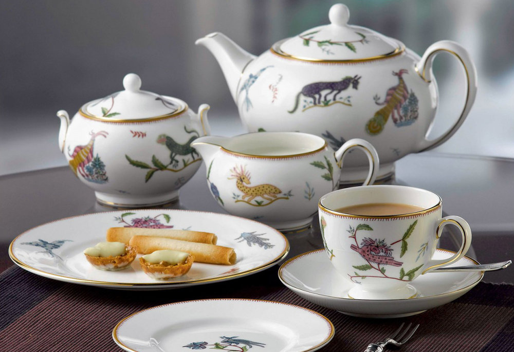 A tea setting using Kemp's Mythical Creatures collection for Wedgwood.