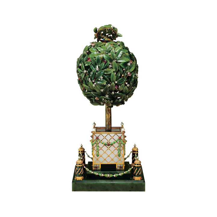 The Bay Tree Easter Egg is the counterpart to the Fifteenth Anniversary Egg and was presented by Tsar Nicholas II to his mother the Easter of 1911. This image displays the egg with its top open, revealing a songbird that animates and sings.