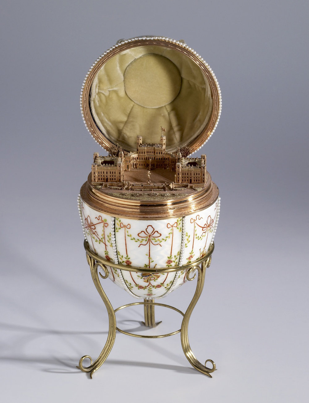 Gatchina Palace Egg, image from the Walters Art Museum. Made in 1901 for the Dowager Empress Maria Feodoronova, the egg contains a miniature model of Gatchina Palace—the Empress's residence outside Saint Petersburg—rendered in gold.