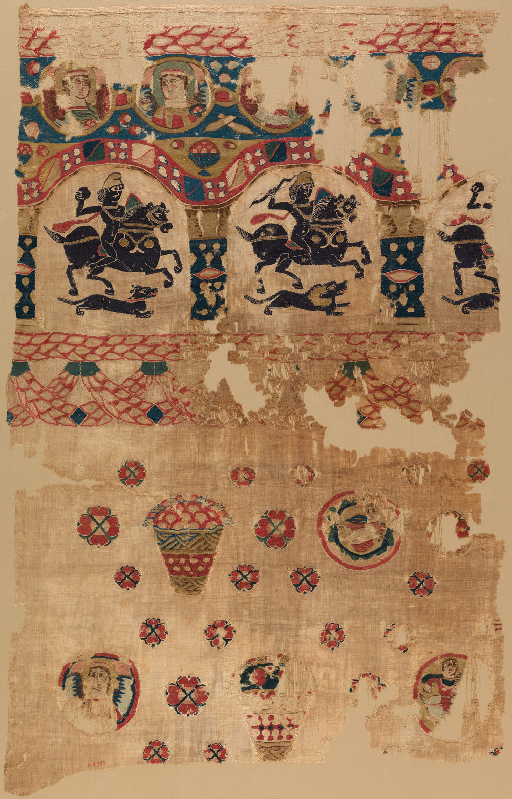 "A fragment from the Metropolitan Museum of Art's collection, woven by Coptic Christians in 5th Century Egypt. ""Arcades containing hunters on horseback recall Roman sources, while the roundels with angels are clearly Christian. Similar imagery, such as the baskets of fruit, is found on the wall paintings of Umayyad desert palaces in Syria […] Such textiles were woven in well‑organized workshops that continued to function in the early Islamic period."""